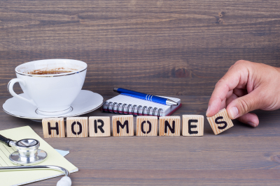 Hormones wooden letters on dark background