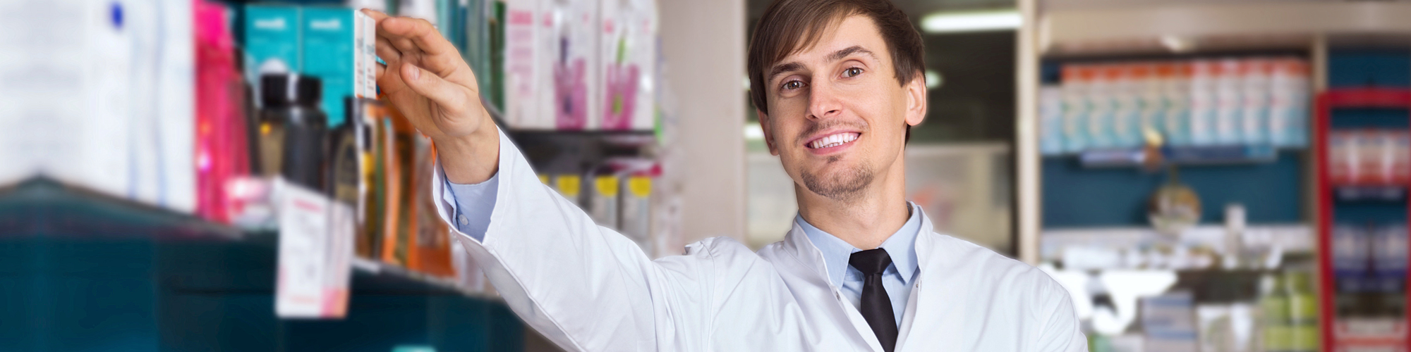 male doctor looking at camera while smiling